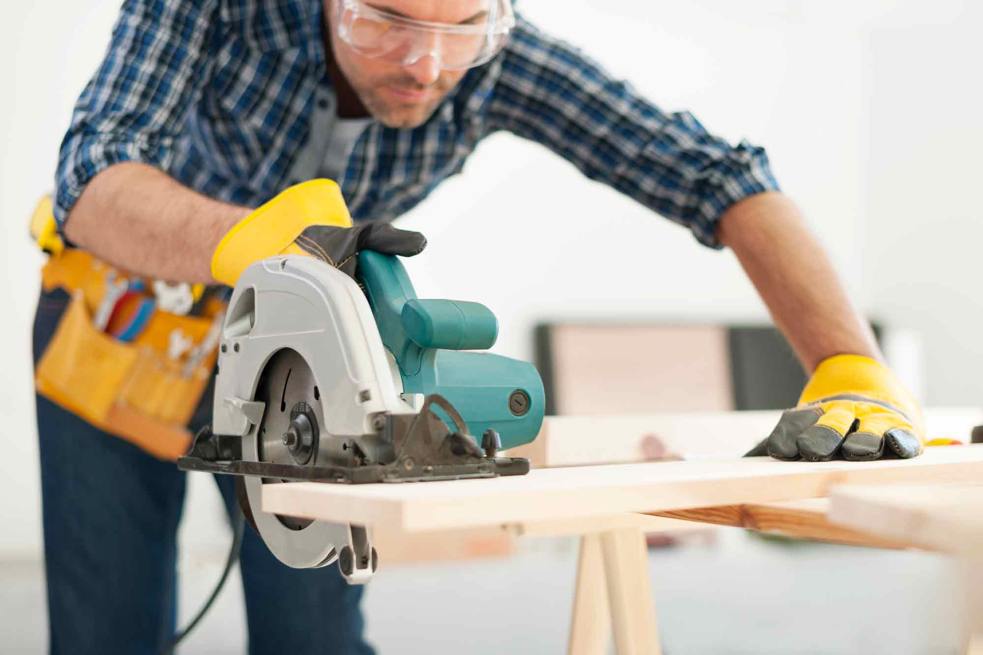 man woodworking with circular saws