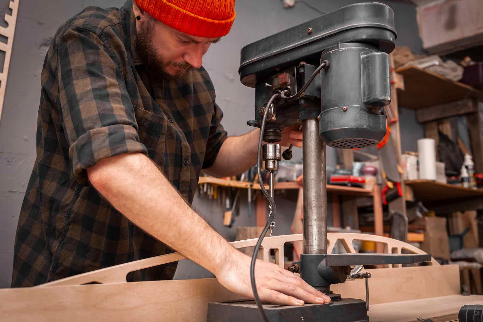man using a drill press